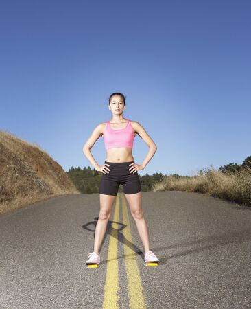 confrontational: Portrait of woman standing in the road