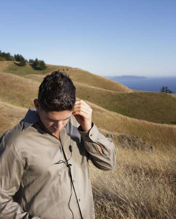 Man listening to electronic device Stock fotó