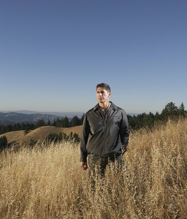 Man standing in hilly terrain Stock Photo - 16071413