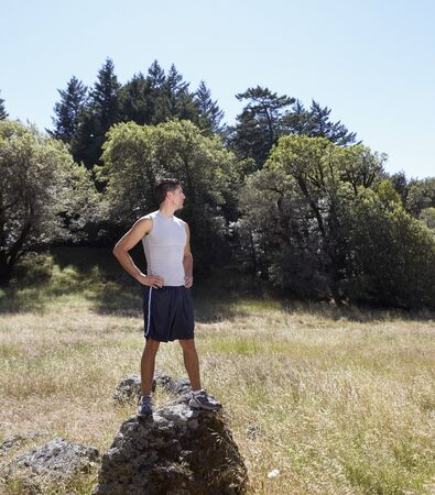 Man standing on a rock in the wilderness Stock Photo - 16071423