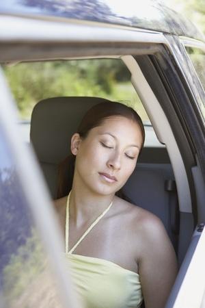 Woman sleeping in passenger seat of SUV Stock Photo