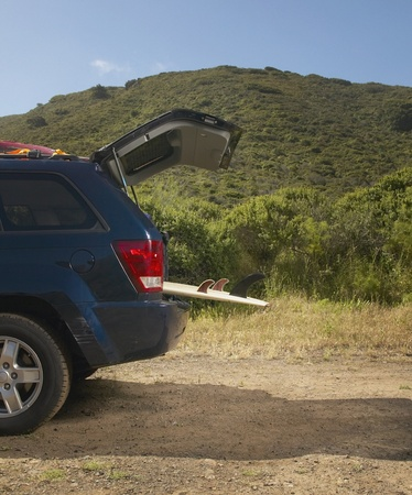the back gate: Still life of surfboard in SUV cargo area