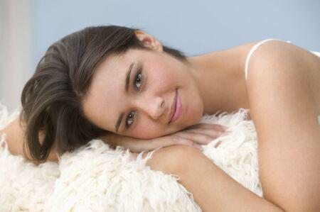 Teenage girl relaxing on a fur rug Stock Photo - 16071470