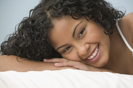 all under 18: Teenage girl reclining and smiling