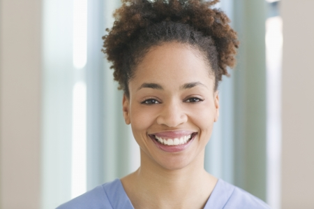 Female medical assistant wearing scrubs Stock Photo - 16071485