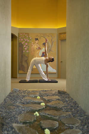 above 30: Young woman exercising in a health spa