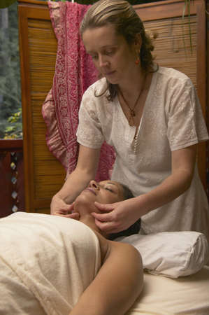 Young woman getting a massage by a massage therapist Stock Photo - 16071513