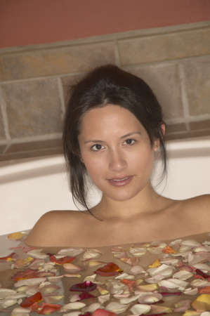 Portrait of a young woman sitting in a bathtub Stock Photo - 16071520