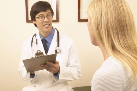 Male doctor talking to a female patient Stock Photo
