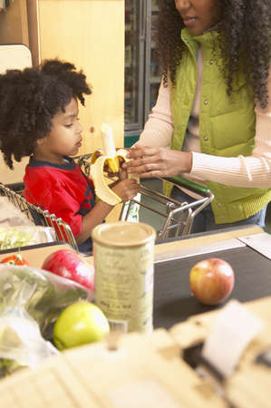 jamaican ethnicity: Mother with her son in a supermarket