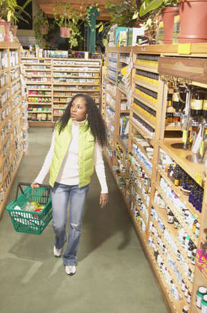 jamaican ethnicity: High angle view of a mid adult woman in a supermarket