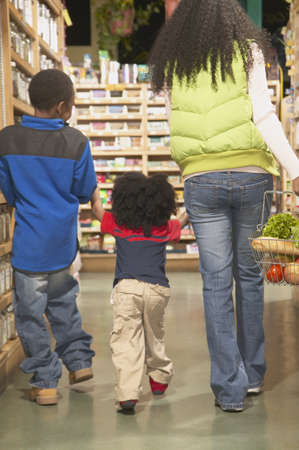 jamaican ethnicity: Mother shopping in a supermarket with her two sons