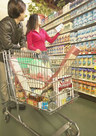 Young couple shopping in a supermarket Stock Photo - 16071589