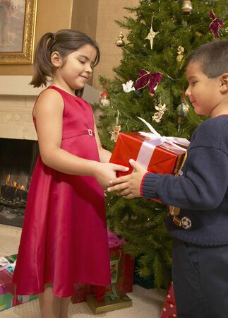 Brother sharing gifts with his sister