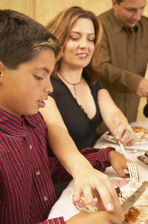 Mother helping her son at the dining table Stock Photo - 16071615