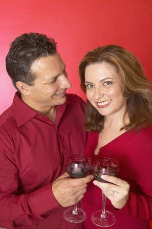 mid adult couple: Mid adult couple holding wine glasses