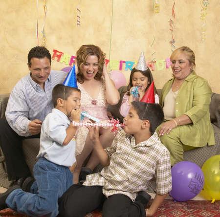 some under 18: Family celebrating a birthday party
