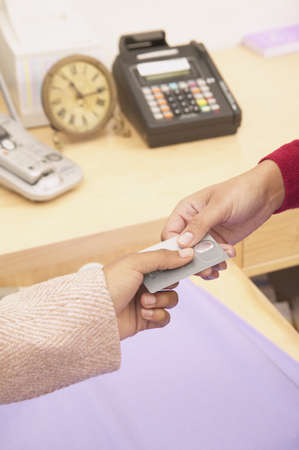 Person making payment with a credit card Stock Photo - 16071656