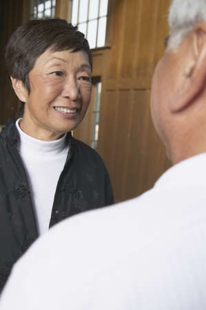 above 30: Close-up of a senior man talking to a senior woman