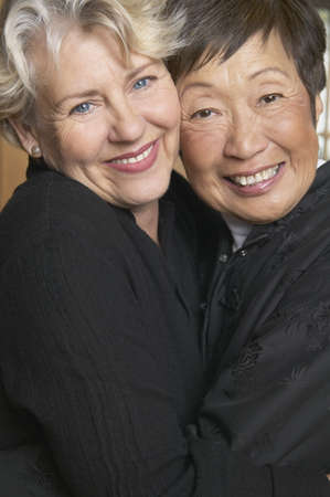 above 30: Portrait of two senior women smiling