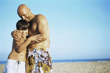 safe water: Father hugging son at the beach