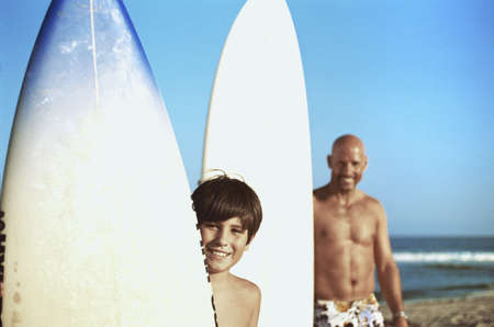 Father and son posing with surfboards Stock Photo - 16071688
