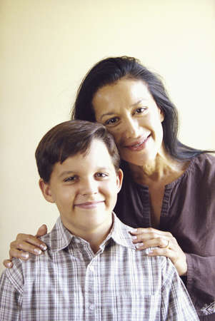 mixed age range: Mother and son posing in family portrait LANG_EVOIMAGES