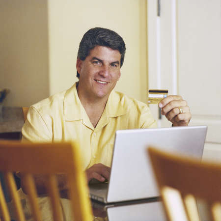 Man using credit card for online purchase Stock Photo - 16071699