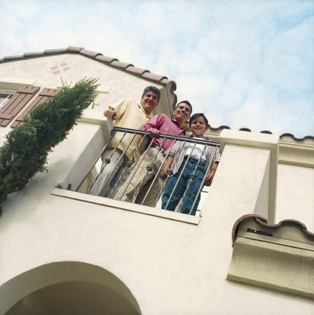 balcony: Three males standing on home balcony LANG_EVOIMAGES