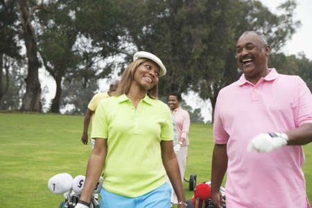 minority couple: Two couples play golf together