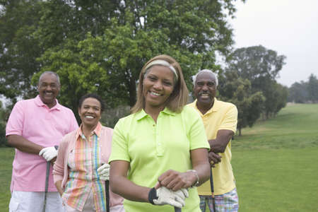 minority couple: Two couples playing golf together LANG_EVOIMAGES