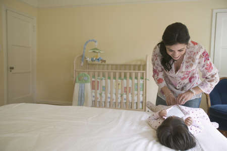 changing diaper: Mother changing diaper of toddler girl LANG_EVOIMAGES