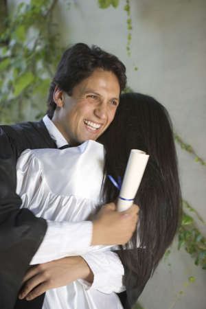Graduating man and woman hugging each other Stock Photo - 16071727