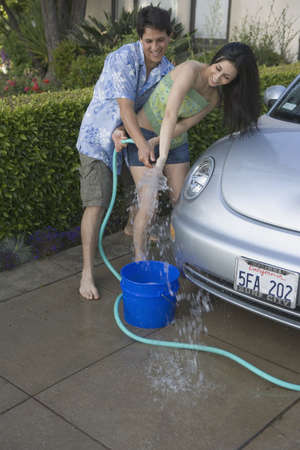 Young couple washing car together Stock Photo - 16071730