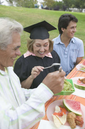 Older graduate celebrating with family Stock Photo - 16071737
