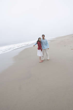 Couple posing on foggy beach Stock Photo - 16071741