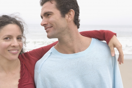 Couple hugging at the beach Stock Photo - 16043296