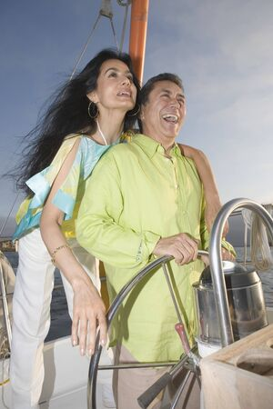 Couple enjoying a sailboat cruise Stock Photo - 16071744