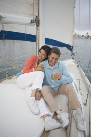Couple enjoying their sailboat Stock Photo - 16071747