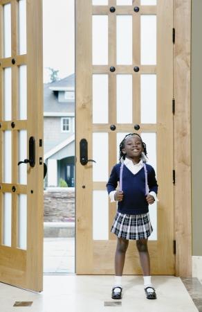 Girl by open doorway Stock Photo - 16071753