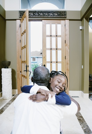 Girl hugging man at home Stock Photo - 16071755