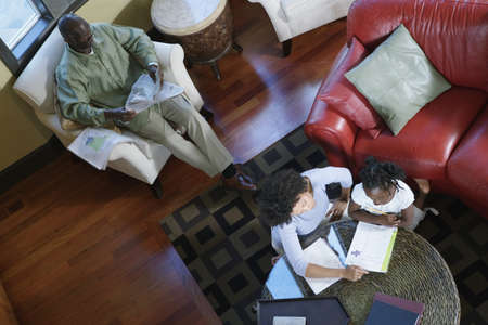 Family reading in home Stock Photo - 16071767