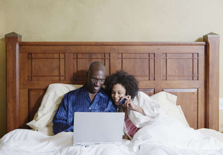 Couple looking at laptop Stock Photo - 16071777