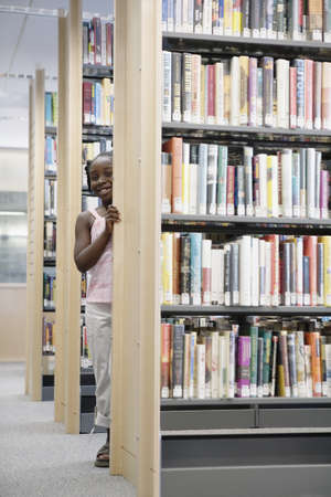 silliness: Girl standing in library  LANG_EVOIMAGES