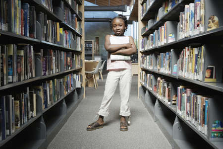 Girl standing in library Stock Photo - 16071790