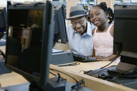 Man and girl posing by computers Stock Photo - 16071796