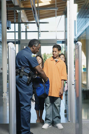 Security officer checking bag Stock Photo - 16071798
