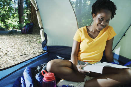 above 18: Woman sitting in tent