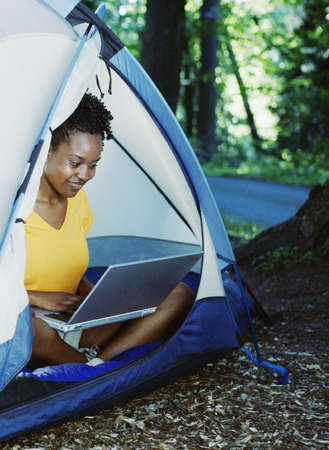 above 18: Woman using laptop in tent