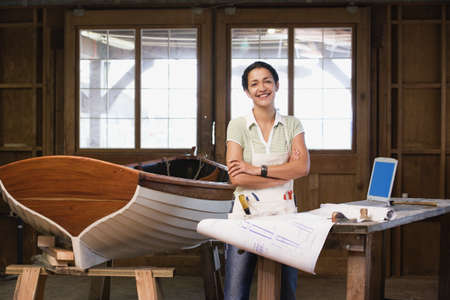 Portrait of woman looking at plans in workshop Stock Photo - 16071905